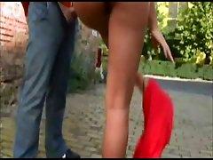 Zafira gives a handjob outdoors