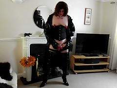 masturbating  tranny in thigh boots, pvc coat and pegs