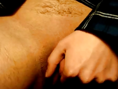 Hairy woman plays with her huge clit