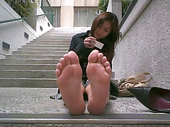 On her lunch break showing her feet