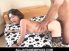 Japanese mature cat with spots has her old pussy split wide and filled with hard cocks