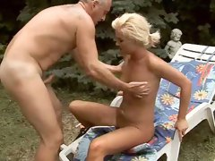 Rapacious grey-haired daddy drills fresh pussy of salty blond by the pool