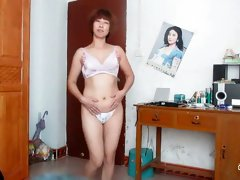 Sweet amateur Chinese lady strips on webcam till topless