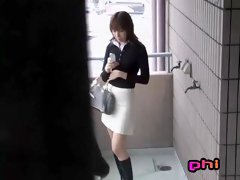 Slim Asian chick texting gets a good skirt sharking.