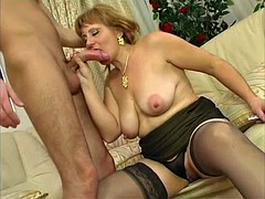 The mature in black lingerie pounded by a young stud