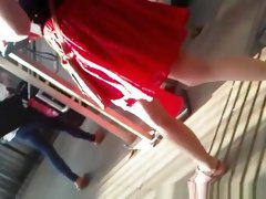 Blonde chick in red skirt upskirted