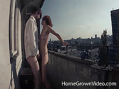 Salacious pornstar gets fucked silly after giving head on the balcony