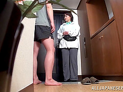 Mature Japanese woman gives great head in the kitchen