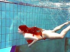 Beautiful redhead Katrin Bulbul looks like a fucking awesome mermaid