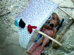 Amazing oral sex taped on the beach under the tent