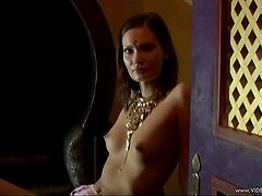 Appreciative lesbian with natural tits giving her horny babes massage in parody shoot