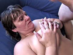 Busty mature gets fucked while smoking