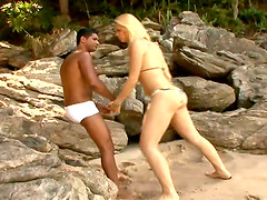 Hot blonde tranny in bikini rides and sucks big black cock