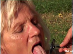 Blonde granny gets some sperm on her glasses