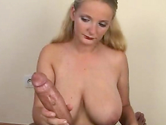Hot blonde shows off her massive tits before jerking a guy off
