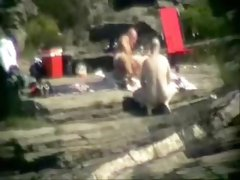 Wife having fun with strangers at beach. Public nudity