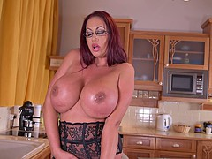 Busty mom has solo fun in the kitchen