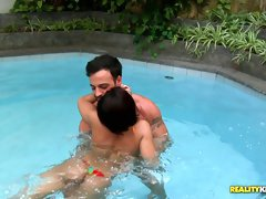 Charming brunette falls in love with big cock in the pool