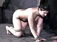 Pain for the girl with a rope around her neck