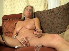 Busty mature blonde gets naked and pleases her shaved cunt