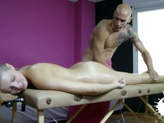 Bald headed masseur gives massage to one sexy and slender chick