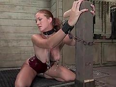 Lusty redhead gets spanked and brutally fucked doggy style in BDSM vid