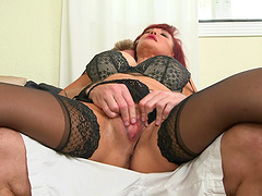 Curvaceous redhead mom gets her twat pounded by younger stud