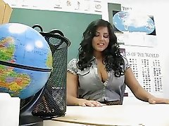 Classy brunette teacher shows off her big boobs