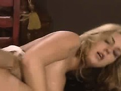 Sexy blonde gets fucked on the table