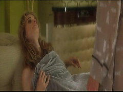 Rachel Blanchard lying on a couch as a couple guys begin to