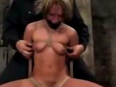 Slim Girl With Mouth Gag Getting Her Tits Bondaged Tied To Chair Stimulated With Vibrator In The Dungeon
